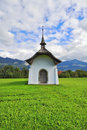 Small rural chapel on a meadow Royalty Free Stock Photo