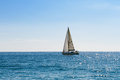 Small sailing boat in blue and calm sea racing yacht the mediterranean on sky background Stock Photos