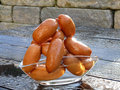 Small sausages chain in glass bowl Royalty Free Stock Photography