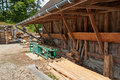Small sawmill lumber mill traditional with a saw table and wood logs Royalty Free Stock Photography