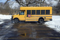 Small school bus on the parking lot Stock Photo