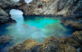 A small sea lagoon with a stone arch, Crete Royalty Free Stock Photo