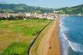The small seaside town in the basque country golf and tractor working on beach no contradictions Royalty Free Stock Images