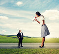 Small senior man and big young woman men women on the road Royalty Free Stock Image