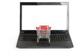 Small shopping cart on laptop, front view Royalty Free Stock Photo