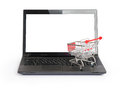 Small shopping cart on laptop Royalty Free Stock Photo
