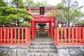 Small shrine with red Torii in Japanese style Royalty Free Stock Photo