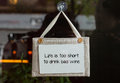 Small sign on a wine shop window saying Royalty Free Stock Photo