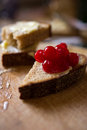 Small sliced piece of wheat bread with cranberries Royalty Free Stock Photography