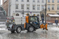 Small snow blower car works in Krakow, Poland. Royalty Free Stock Photo
