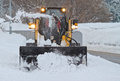 Small snowplow plowing walkway heavy snowfall removing snow walkway Stock Images