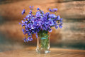 Small spring flowers boquet glass sawg Royalty Free Stock Image