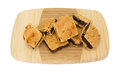 Small square fig bar squares on a wood cutting board Royalty Free Stock Photo