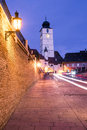 Small square in sibiu with the old tower council transylvania romania Stock Photo