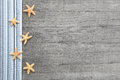 Small Starfishes On Grey Woode...