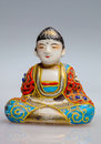 Small statuette of buddha color made porcelain japan Royalty Free Stock Photos