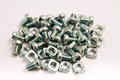 Small steel nuts and bolts Stock Image