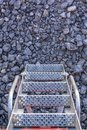 Small step ladder on hydraulic machinery