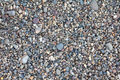 Small stones pebbles sand background Royalty Free Stock Photo