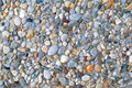Small stones texture photo of orange sand Stock Images