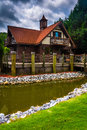 Small stream and red-roofed building in Helen, Georgia. Royalty Free Stock Photo