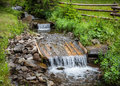 Small stream with water cascade flowing through idyllic landscape ukraine Royalty Free Stock Images