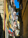 Small street in ribeira porto one of many medieval streets and alleyways district portugal Royalty Free Stock Images