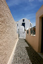 Small street on santorini island and blue greek sky Stock Photo