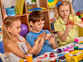 Small students girl finger painting in art school class. Royalty Free Stock Photo