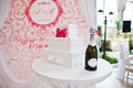 Small table with box for money and champagne at wedding ceremony Royalty Free Stock Photo
