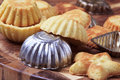 Small tart shells and baking pans Royalty Free Stock Photo