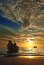 Small thai boat at tropical sunset Royalty Free Stock Photo