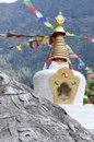 Small tibetan stupa in nepal with sacred mani stones object of worship Stock Photography