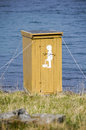 Small toilet facility placed sea side Stock Photography