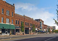 Small town main street a photo of a typical in the united states of america features old brick buildings with specialty shops and Royalty Free Stock Photos