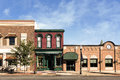 Small town main street a photo of a typical in the united states of america features old brick buildings with specialty shops and Royalty Free Stock Photography