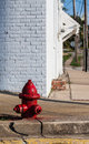 Small town street fire hydrant front of white building Stock Images