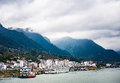 Small town at Yangtze river`s edge with mountain and cloud background Royalty Free Stock Photo