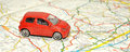 Small Toy Car On Road Map Royalty Free Stock Photo