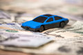 Small toy car on usa dollar Royalty Free Stock Photo