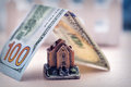 Small toy house with money Royalty Free Stock Photo