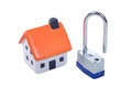 Small toy model of a house with a padlock Royalty Free Stock Photo