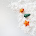 Small toys on snow and white background Stock Photo