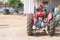 Small tractor with big wheels Royalty Free Stock Photo