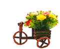 Small tricycle and flower. Royalty Free Stock Image