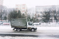 Small truck driving in winter Stock Images