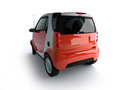 Small urban red car back view Royalty Free Stock Photo