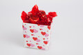 Small Valentine gift box filled with candy Royalty Free Stock Photography