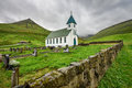 Small village church with cemetery in Gjogv, Faroe Islands, Denmark Royalty Free Stock Photo