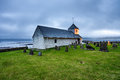 Small village church with cemetery in Kirkjubour, Faroe Islands, Royalty Free Stock Photo